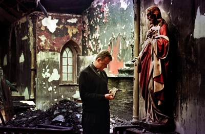 Father David Delargy,  a priest at St James church, Crumlin,  holds a broken hand from a statue of Christ in the 200 year old chapel.  The chapel was firebombed along with seventeen other catholic churches across Northern Ireland during the first week of the stand-off at Drumcree in 1998.